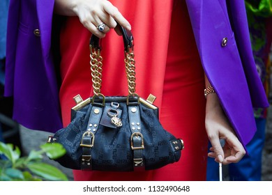 660b0566cc8 MILAN - JUNE 16  Woman with black and golden Versace bag