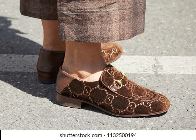 MILAN - JUNE 16: Woman with brown velvet Gucci shoes in sunlight before Marni fashion show, Milan Fashion Week street style on June 16, 2018 in Milan.