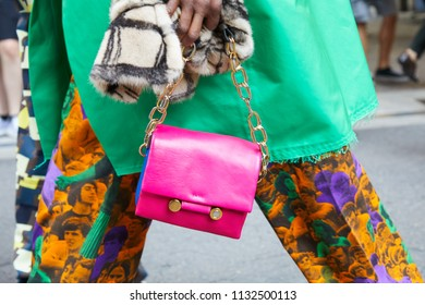MILAN - JUNE 16: Woman with pink leather bag with golden chain and green dress before Marni fashion show, Milan Fashion Week street style on June 16, 2018 in Milan.