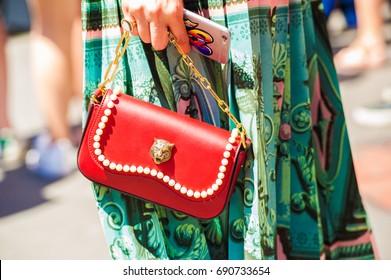 MILAN, JUNE 18, 2017: woman poses for photographers before FERRAGAMO fashion show at Milan Men's Fashion Week street style Spring/Sumer 2018