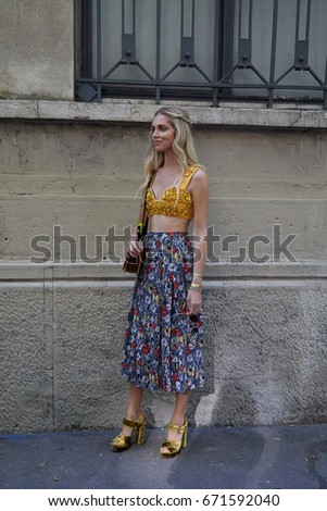 1253fd0a03 MILAN - JUNE 18  Chiara Ferragni with floral skirt and yellow tube top  before Prada