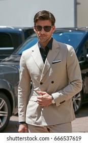 MILAN - JUNE 18: Johannes Huebl with beige suit before Salvatore Ferragamo fashion show, Milan Fashion Week street style on June 18, 2017 in Milan.