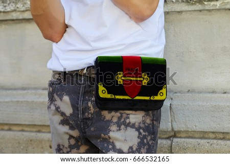 464e23fde531 MILAN - JUNE 18: Man with Prada green and red bag and Louis Vuitton belt