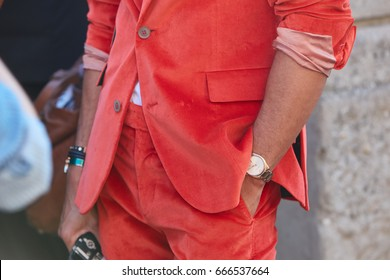 MILAN - JUNE 18: Man with red coral suit and Emporio Armani watch before Prada fashion show, Milan Fashion Week street style on June 18, 2017 in Milan.