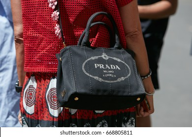 bbdd43146715ee MILAN - JUNE 18: Woman with Prada black fabric bag and red dress before  Salvatore