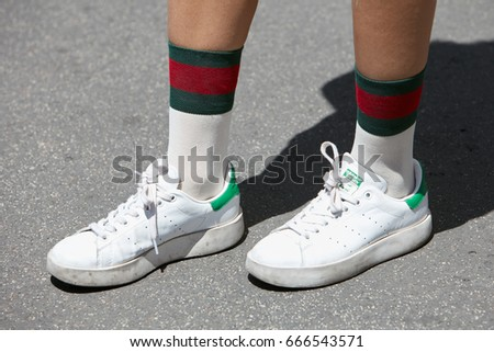 699b003ac1f MILAN - JUNE 18  Woman with white and green Adidas Stan Smith shoes and  Gucci