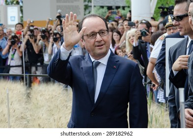MILAN, JUNE 21, 2015: French President, Francois Hollande, greets his supporters at the entrance of the French pavilion at Expo Milan 2015 on the occasion of the French National Day.