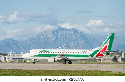 Milan Linate, Italy - October 6th, 2017: An Alitalia Embraer E175LR Cityliner taxiing at Milan Linate Airport. These planes operate short-haul flights within Italy and Europe