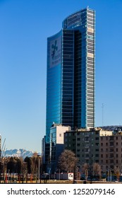 Milan, Lombardy, Italy- December 29 2017:This is 'Pirellone' skyscraper Palace of Government of Lombardy region.We can see also on the backround mountain whit snow.