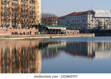 Milan, Lombardy / Italy - February 22nd 2019: People and tourists in famous Navigli District area. Ancient harbour where Naviglio Pavese and Naviglio Grande canals meet.
