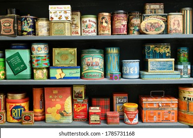 Milan, Lombardy, Italy - July 10, 2020 : Large collection of colorful vintage cans displayed on a shelf used as retail packaging with brand advertising and arranged according to color