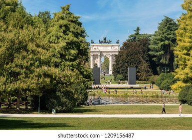 MILAN, LOMBARDY, ITALY - SEP 24, 2016: Arco della Pace (Arch of Peace 1814) in the Parco Sempione (Sempione park) is a large city park in downtown of Milan, Italy