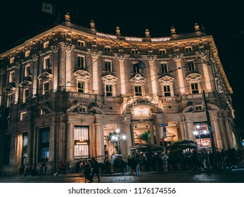 Milan, lombradia / Italy - September 9, 2018: Starbucks opening during night, buil​ding is light up.