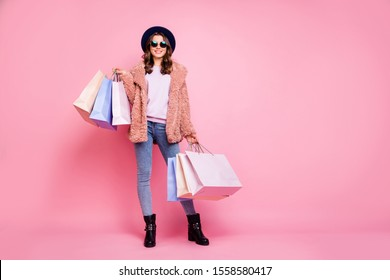 Milan I love you! Full length photo of pretty model lady carry many packs enjoy abroad sales shopping wear fluffy jacket jeans sun specs hat shoes isolated pink background