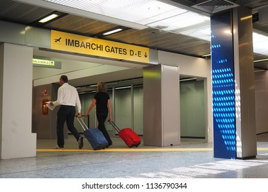 Milan Malpensa Airport, Italy- 12th June, 2017: people with luggage going to gates
