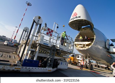 MILAN MALPENSA AIRPORT - JULY 22, 2015: Loading operation for a Boeing 747-400 Freight of Cargolux Airlines at Milan Malpensa Airport.