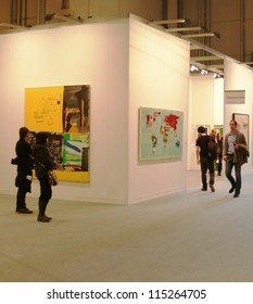 MILAN - MARCH 27: Looking at paintings galleries during MiArt ArtNow, international exhibition of modern and contemporary art March 27, 2010 in Milan, Italy.