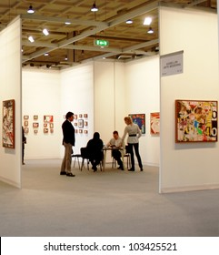 MILAN - MARCH 27: People look at paintings galleries during MiArt ArtNow, international exhibition of modern and contemporary art March 27, 2010 in Milan, Italy.