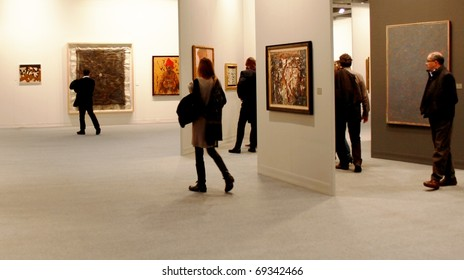MILAN - MARCH 27: People look at painting and sculptures galleries during MiArt ArtNow, international exhibition of modern and contemporary art March 27, 2010 in Milan, Italy.
