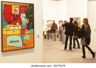 MILAN - MARCH 27: People visit paintings galleries at MiArt ArtNow, international exhibition of modern and contemporary art March 27, 2010 in Milan, Italy.