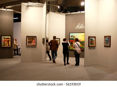 MILAN - MARCH 27: People walk trough work of arts galleries during MiArt ArtNow, international exhibition of modern and contemporary art March 27, 2010 in Milan, Italy.