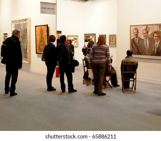 MILAN - MARCH 27: People walk through work of arts galleries during MiArt ArtNow, international exhibition of modern and contemporary art March 27, 2010 in Milan, Italy.