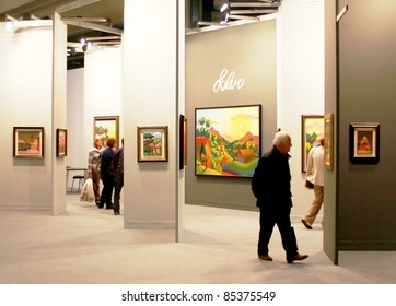 MILAN - MARCH 27: Visitors look at work of arts galleries during MiArt ArtNow, international exhibition of modern and contemporary art March 27, 2010 in Milan, Italy.
