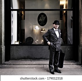 MILAN - MAY 3: Old gentleman with hat and pipe in front of Borsalino's shopwindow, most famous italian hats shop, May 3, 2013 in Milan, Italy.