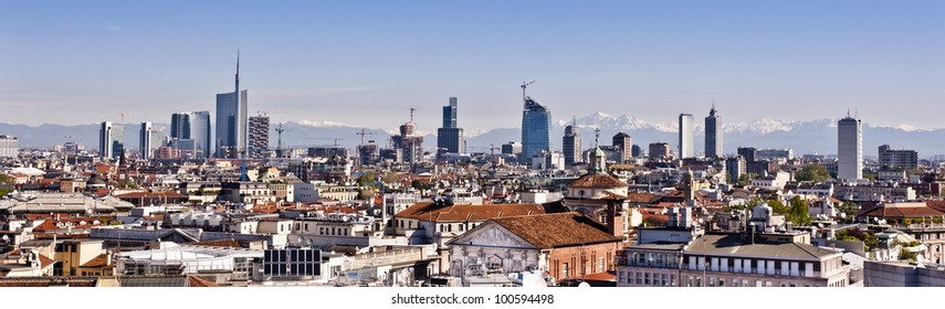Milan, new panoramic skyline. The picture was taken from the Duomo cathedral and shows the new buildings from the Garibaldi district. The alps, less than 50 miles away, are on the background.