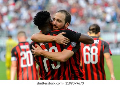 MILAN - OCT 7, 2018: Gonzalo Higuain celebrates the goal with Franck Kessie. AC Milan - Chievo. San Siro stadium. Serie A.