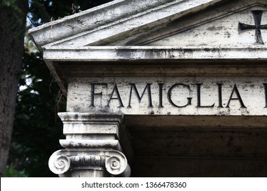 Milan - old grave at the Monumental Cemetery. Word famiglia means family.