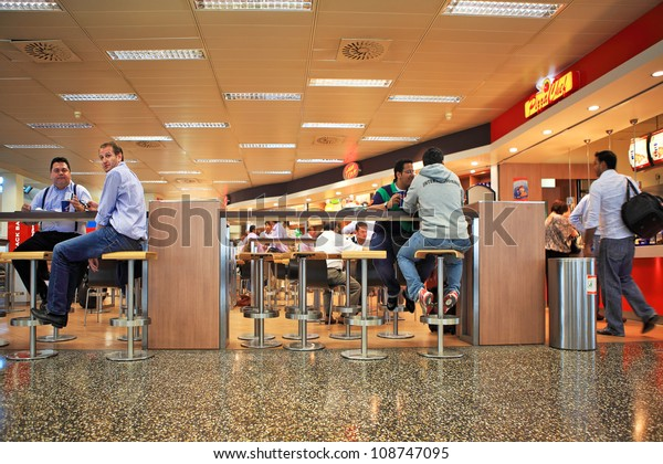MILAN - SEP 21: People sitting in restaurant at Malpensa International Airport - largest airport in northern Italy serves international and domestic flights in Milan, Italy on September 21, 2010.