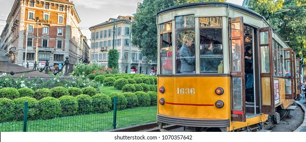 MILAN - SEP 25: Historic tram rides on September 25, 2015 in Milan. Milan transportation system carries 2 million passengers daily.