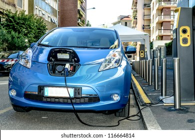 MILAN - SEPTEMBER 13: Electric vehicle in car sharing station. This innovative service allows to pick up and deposit cars in various parking areas around the city, on September 13,2012 in Milan, Italy