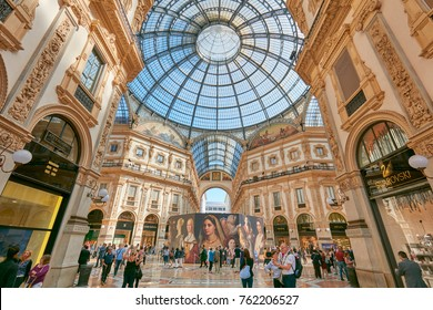 MILAN - SEPTEMBER 20: Galleria Vittorio Emanuele interior with people and luxury shops in a sunny day on September 20, 2017 in Milan. The gallery in the center of the city hosts many luxury stores.