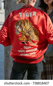 MILAN - SEPTEMBER 20: Man with red bomber jacket with tiger embroidery before Alberto Zambelli fashion show, Milan Fashion Week street style on September 20, 2017 in Milan.