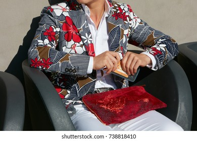 06a9efd73 MILAN - SEPTEMBER 20: Man with red velvet bag and jacket with floral  decoration before