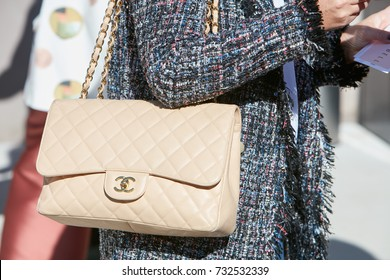 MILAN - SEPTEMBER 20: Woman with beige Chanel leather bag before Alberto Zambelli fashion show, Milan Fashion Week street style on September 20, 2017 in Milan.