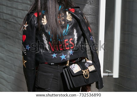 MILAN - SEPTEMBER 20  Woman with black leather jacket with stickers and  Pinko love bag 9603b55b646