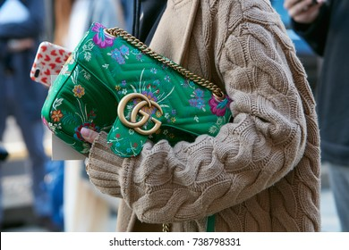 MILAN - SEPTEMBER 21: Woman with beige wool sweater and Gucci bag with floral design chain before Max Mara fashion show, Milan Fashion Week street style on September 21, 2017 in Milan.