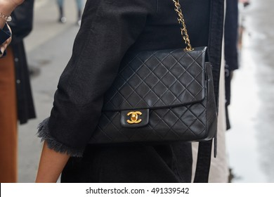 f00b334730f2 MILAN - SEPTEMBER 21  Woman with black Chanel leather bag before Wunderkind fashion  show