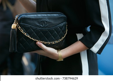 MILAN - SEPTEMBER 21: Woman with black Chanel leather bag and golden watch before Luisa Beccaria fashion show, Milan Fashion Week street style on September 21, 2017 in Milan.
