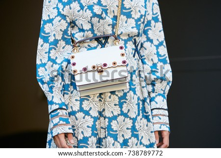 MILAN - SEPTEMBER 21  Woman with Fendi white leather bag and blue and white  leaves e5f87ab000349