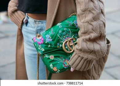 MILAN - SEPTEMBER 21: Woman with green floral design Gucci bag and beige wool sweater before Max Mara fashion show, Milan Fashion Week street style on September 21, 2017 in Milan.