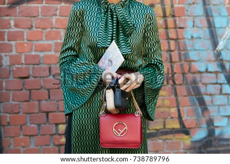 MILAN - SEPTEMBER 21  Woman with green and black dress and red leather  Fendi bag 75054786568de