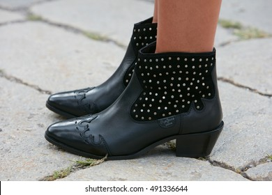 MILAN - SEPTEMBER 21: Woman with Pepe Jeans black leather bootie before Gucci fashion show, Milan Fashion Week street style on September 21, 2016 in Milan.