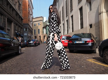 MILAN - SEPTEMBER 22: A fashionable woman posing for photographers in the street before ANTONIO MARRAS fashion show, during Milan Fashion Week spring/summer 2018 on September 22, 2017 in Milan.