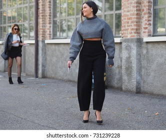 MILAN - SEPTEMBER 22: A fashionable woman walking in the street before AQUILANO RIMONDI fashion show, during Milan Fashion Week spring/summer 2018 on September 22, 2017 in Milan.