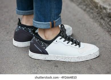 MILAN - SEPTEMBER 22: Man with black and white Hogan rebel shoes before Max Mara fashion show, Milan Fashion Week street style on September 22, 2016 in Milan.
