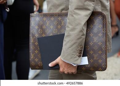 MILAN - SEPTEMBER 22: Man with brown Louis Vuitton bag before Cristiano Burani fashion show, Milan Fashion Week street style on September 22, 2016 in Milan.